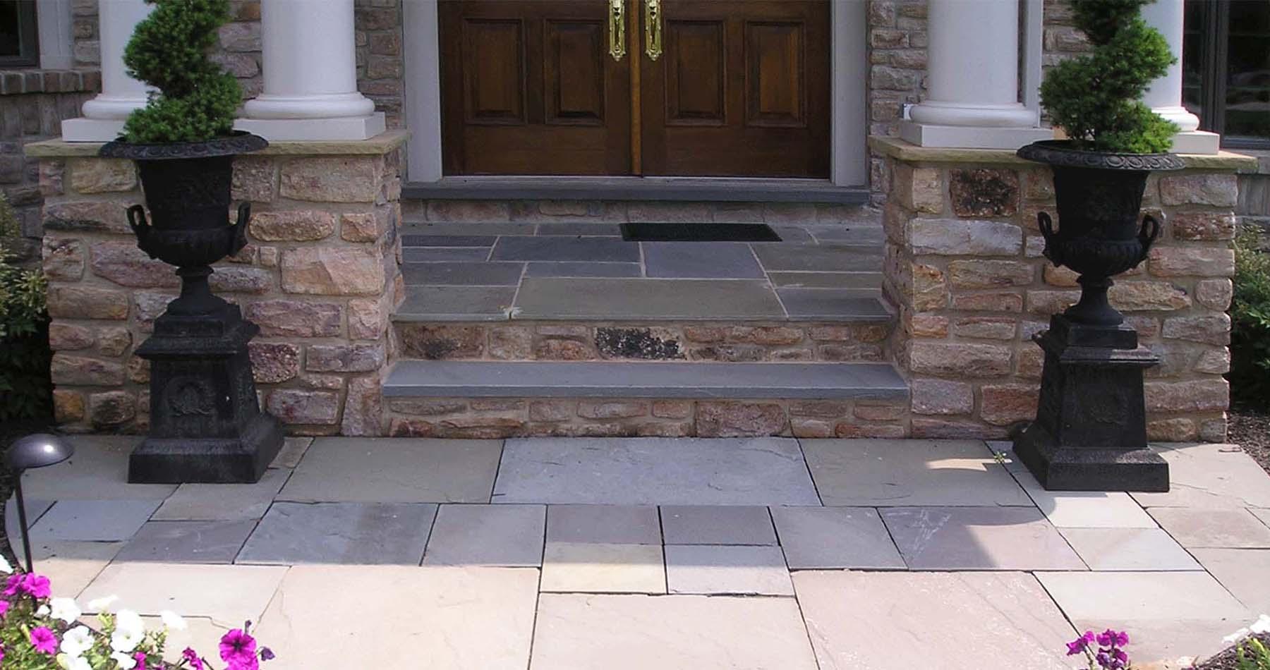 beautiful masonry front steps with bluestone real stone pillars and limestone treads