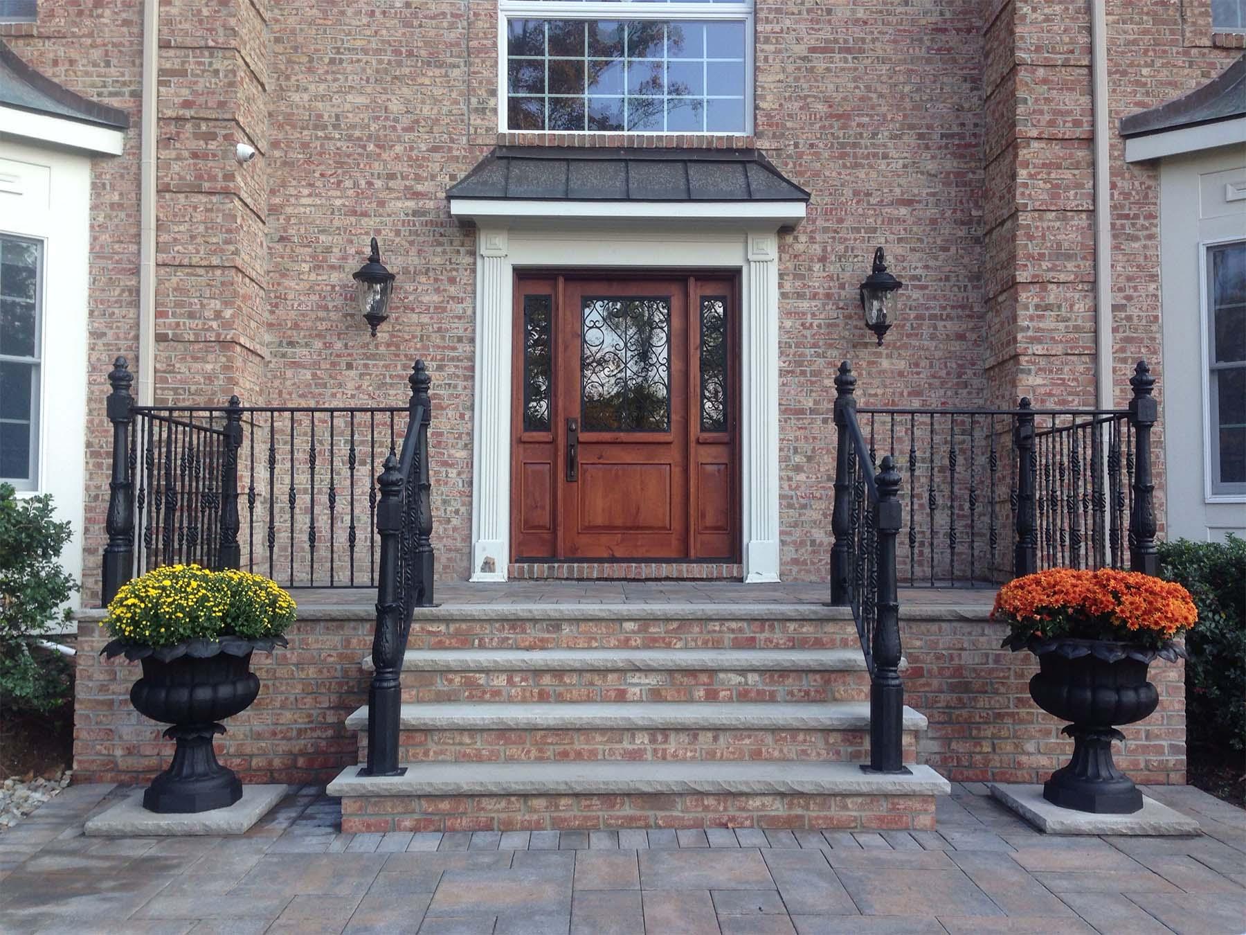 beautiful brick steps with limestone treads black iron railings brick house