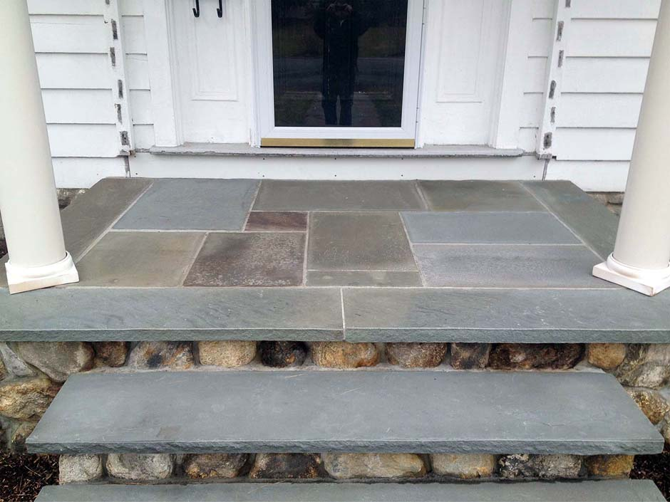 front masonry steps made from blue stone and limestone with real stone risers