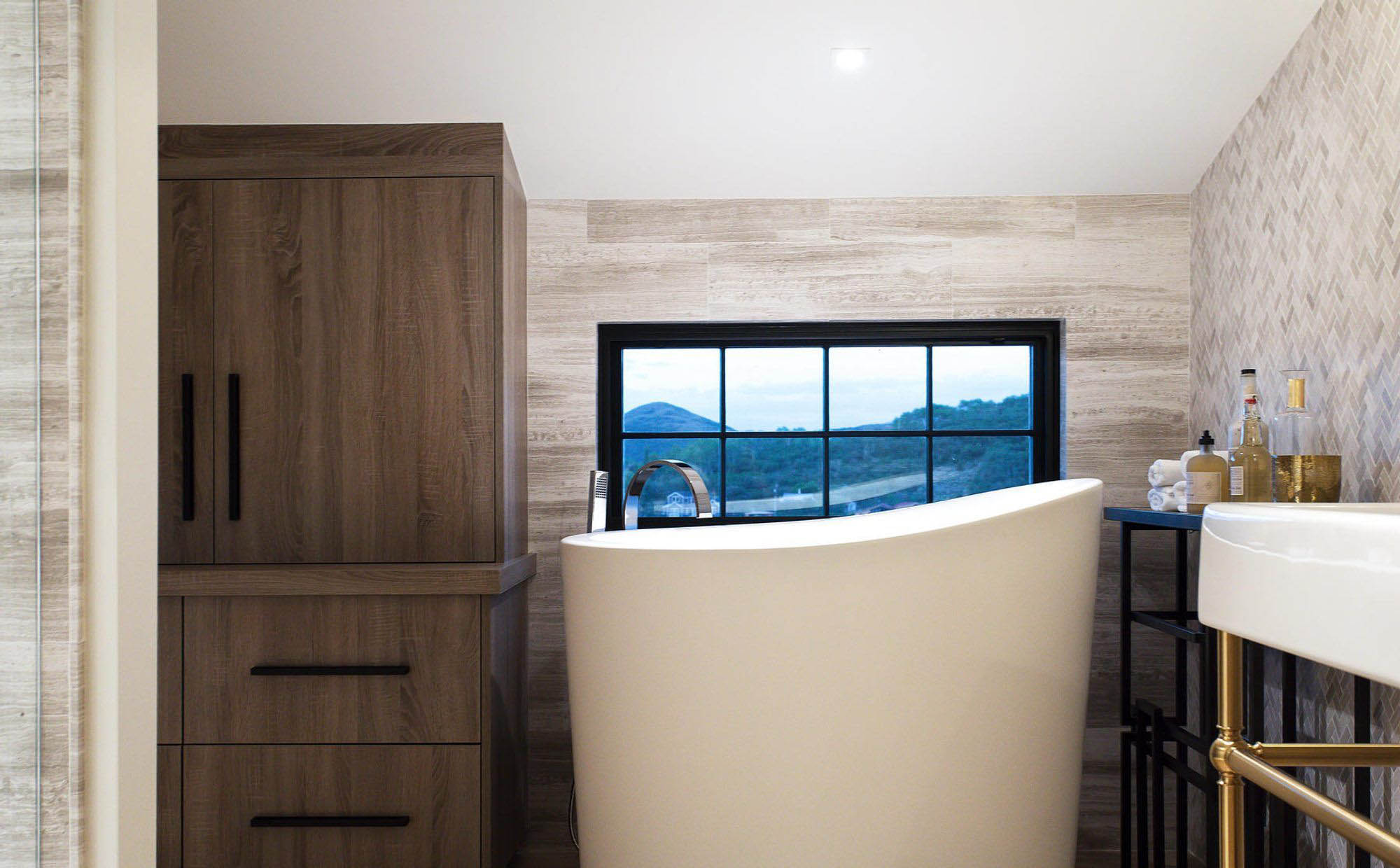cool modern round freestanding soaking tub in a modern bathroom