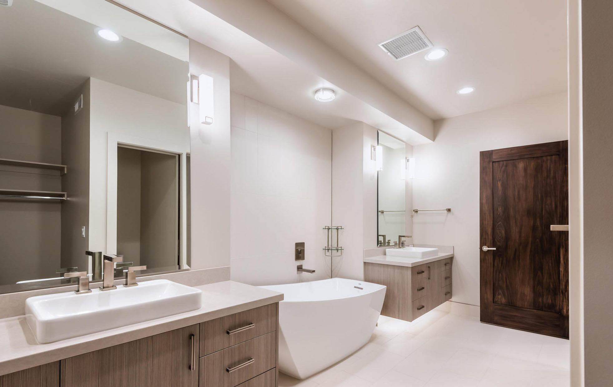Modern bathroom design ideas featuring solid wood slab doors with dark stain.