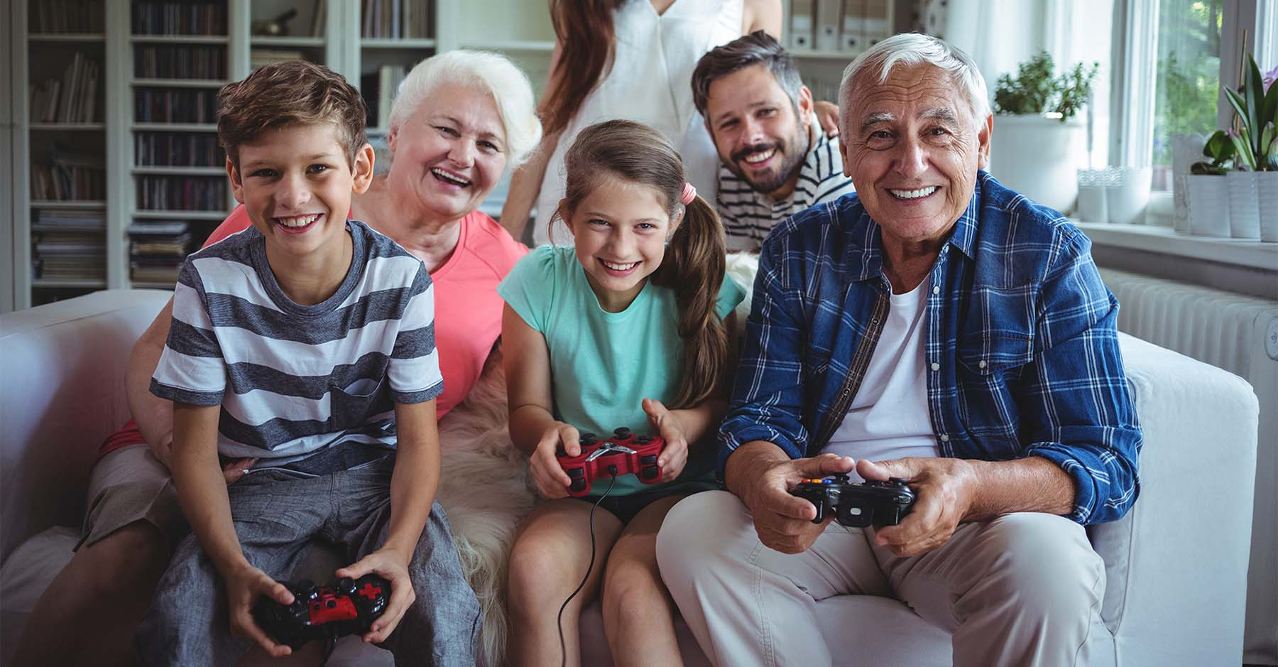 multigenerational home kids playing video games with grandparents