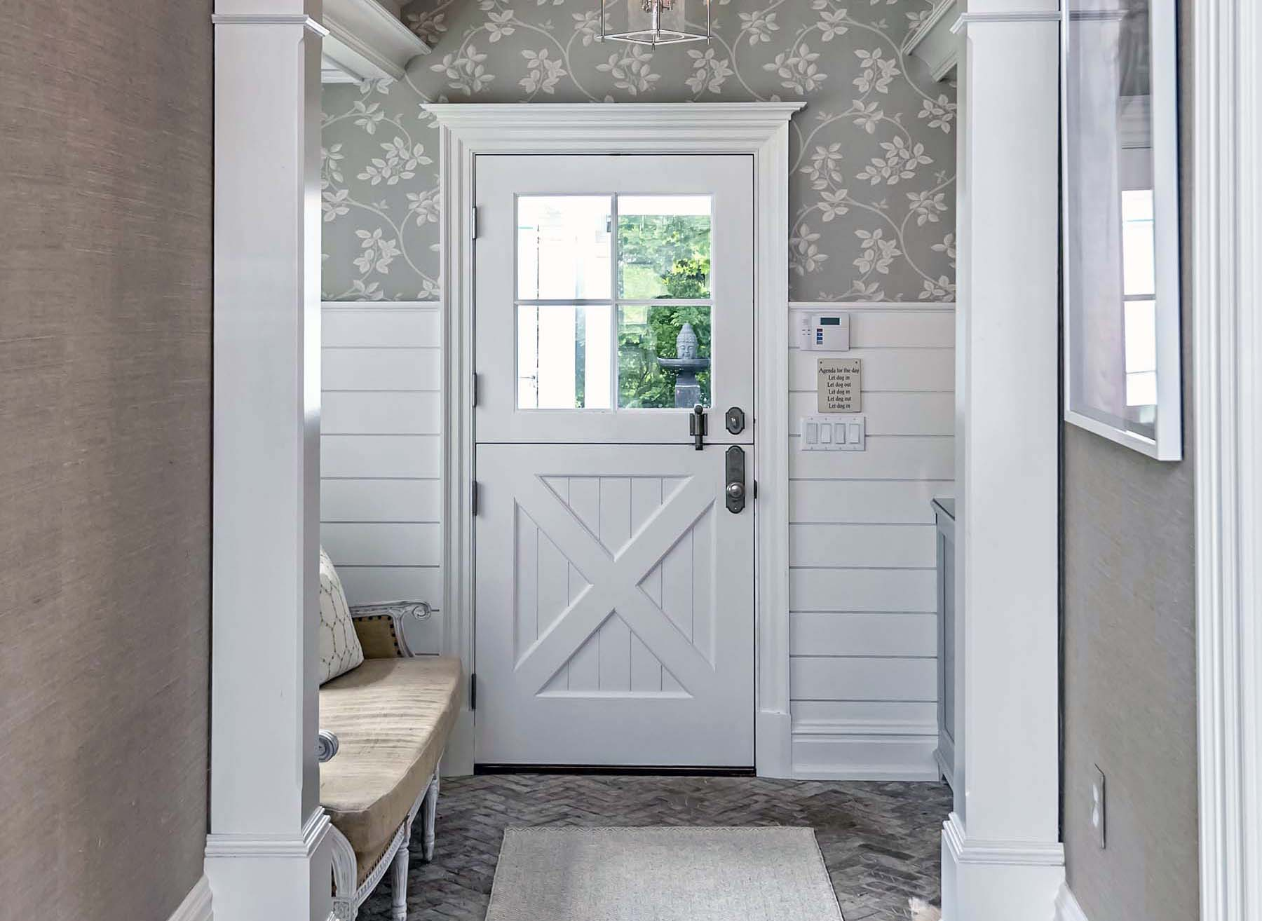 small entryway design ideas white ship lap with a white front door flower wallpaper