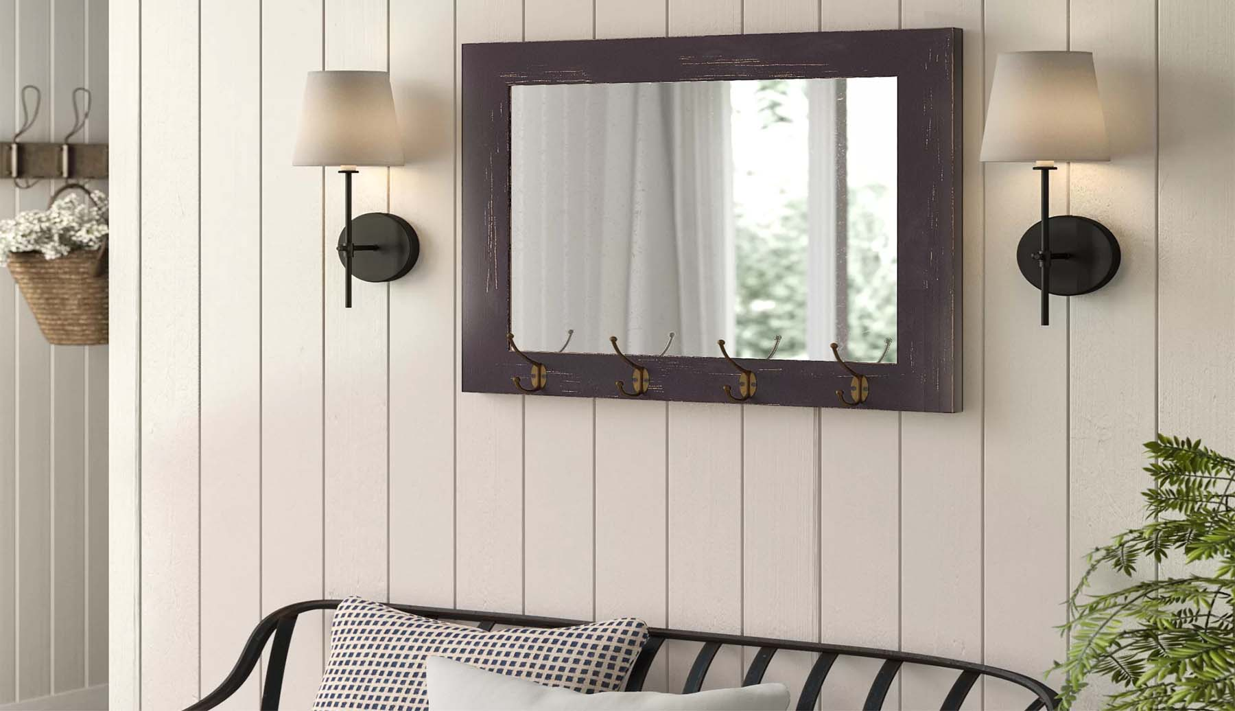 a rectangle wood frame mirror with key hooks vertical wall paneling