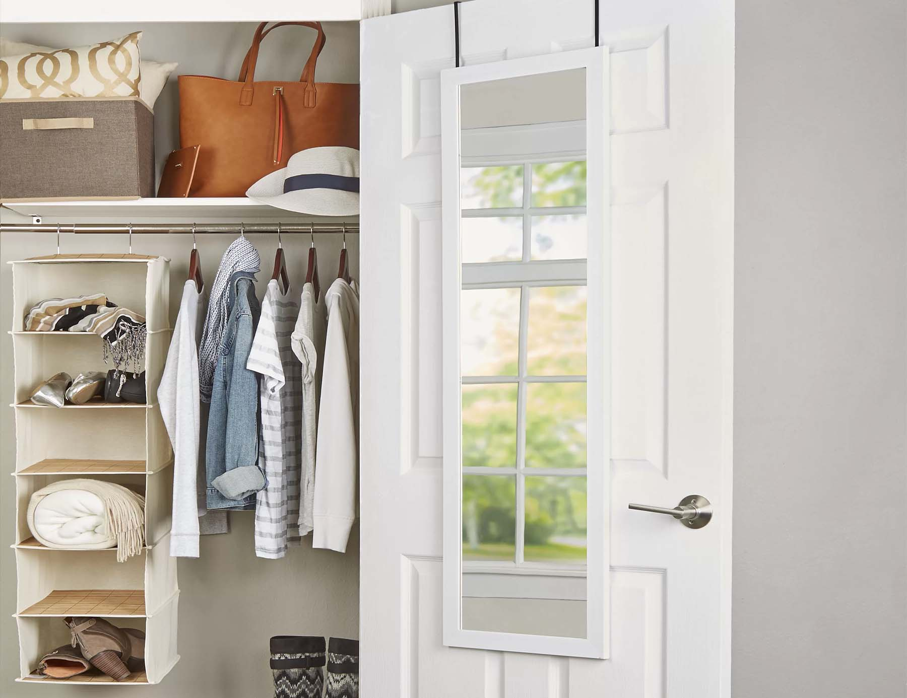 small entryway closet with organizers and door mirror