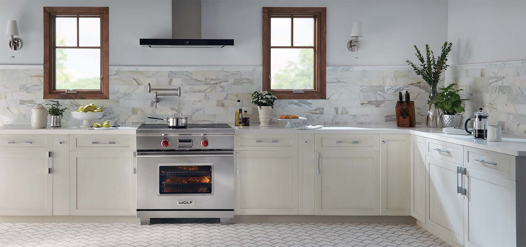 Wolf gas range in a luxury kitchen with marble countertops and back splash