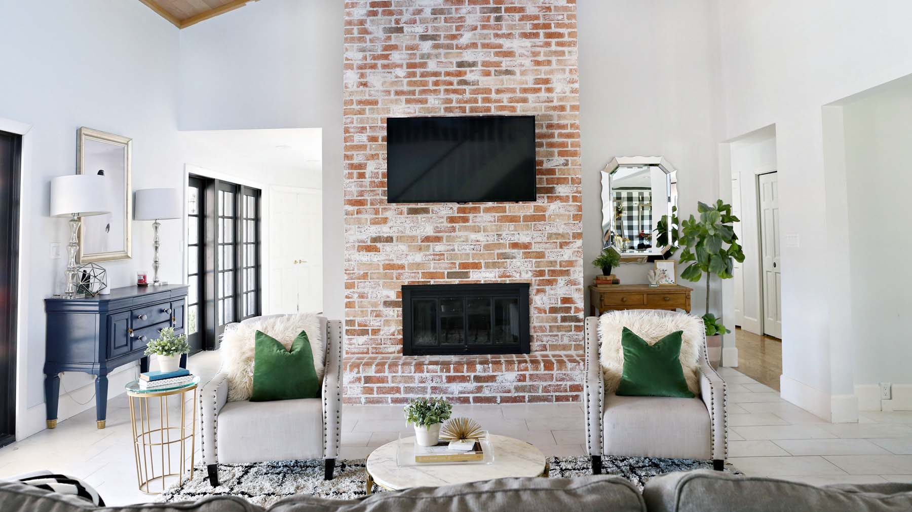 red brick fireplace white washed brick tile floors