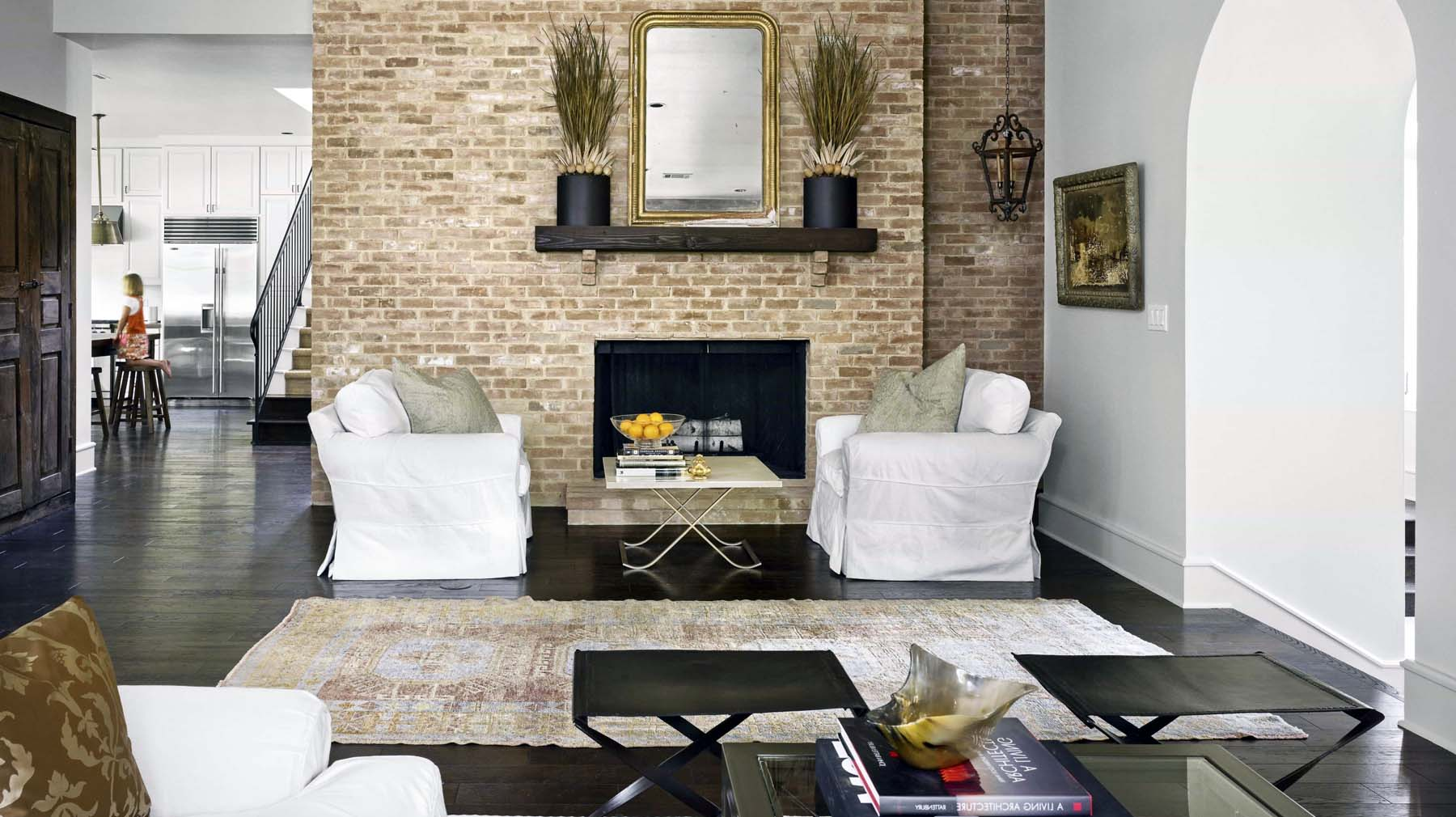 red brick living room fireplace with dark wood floors real wood burning stove
