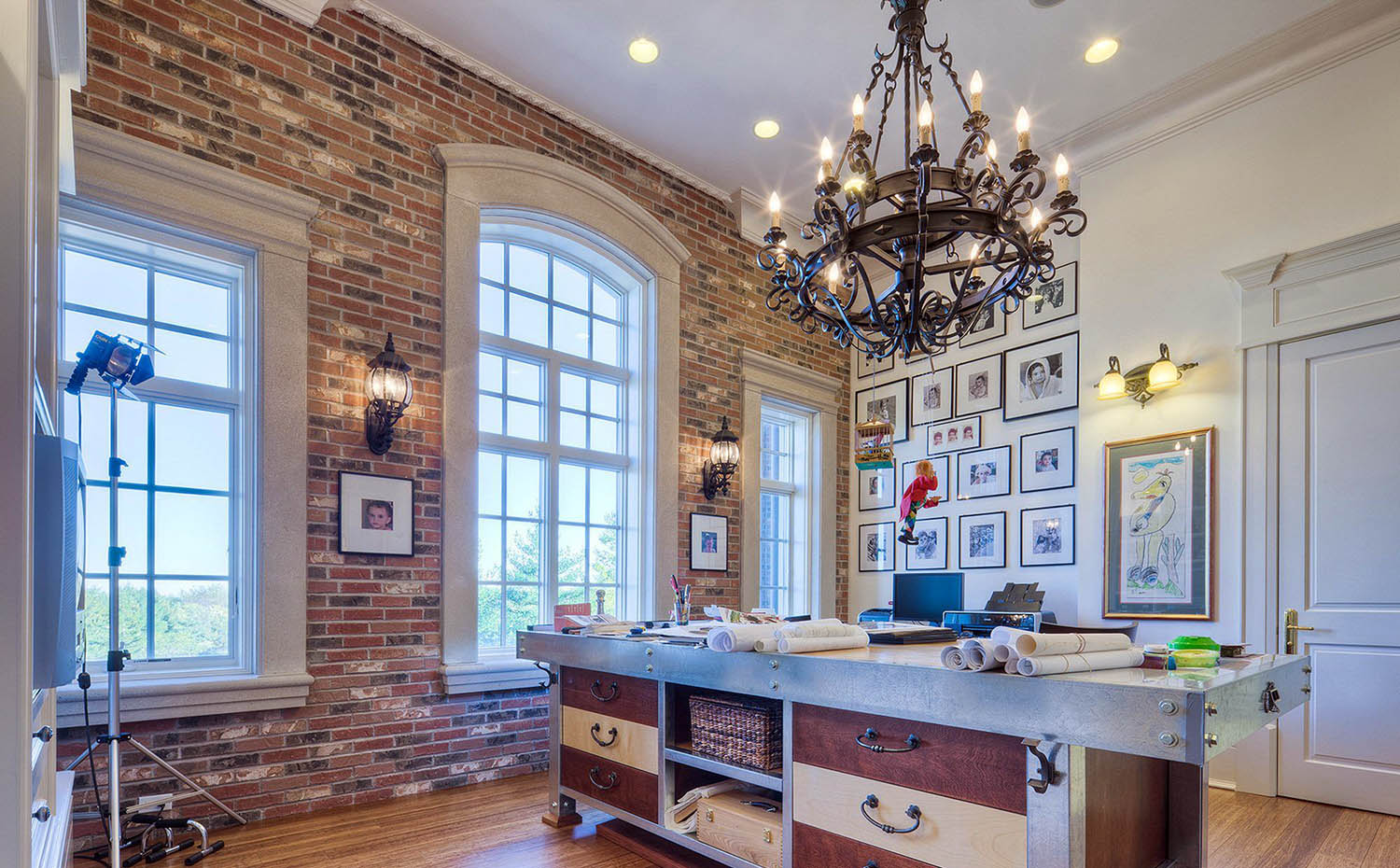 red brick home office accent wall with white wall and ceiling paint.