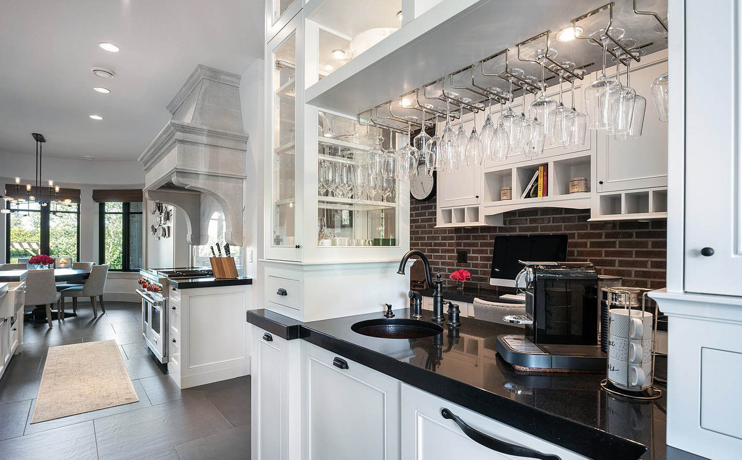 red brick kitchen wall dark red brick gray cement grout white cabinets black stone countertops