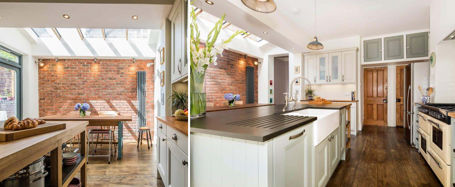 white cabinets with red brick wall black countertops skylights and vaulted ceilings