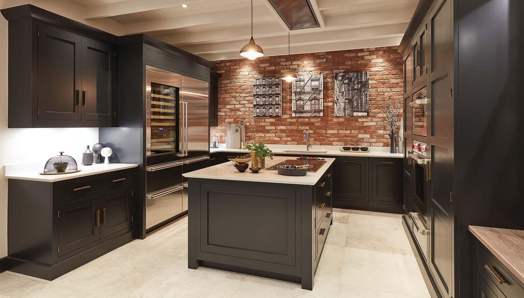 black kitchen cabinets red brick backsplash with artwork white countertops stainless steel appliances