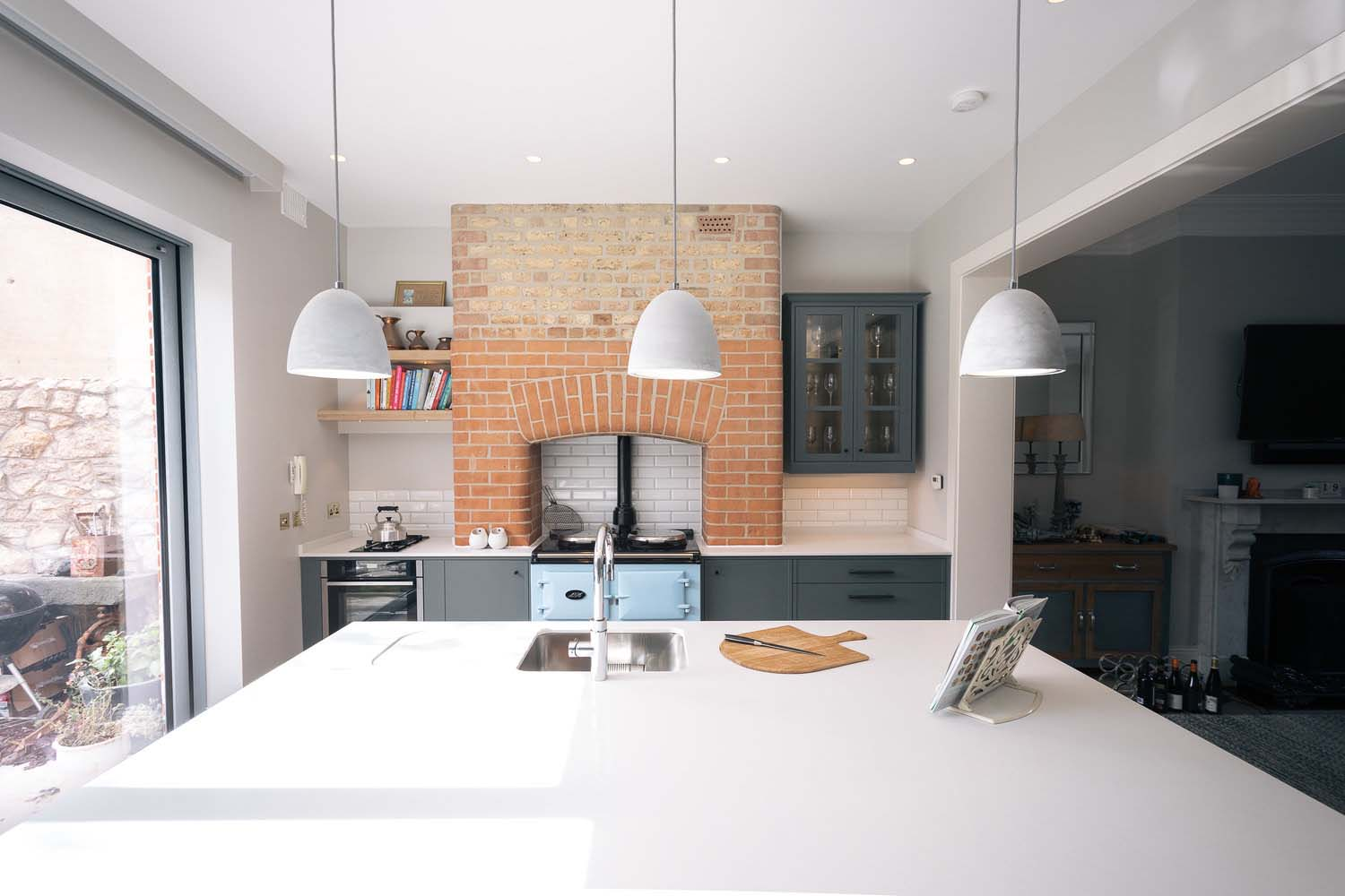 brick kitchen chimney with exposed oven pipes