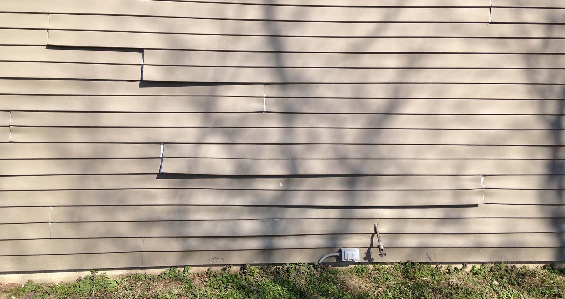 bad vinyl siding installation warping and buckling
