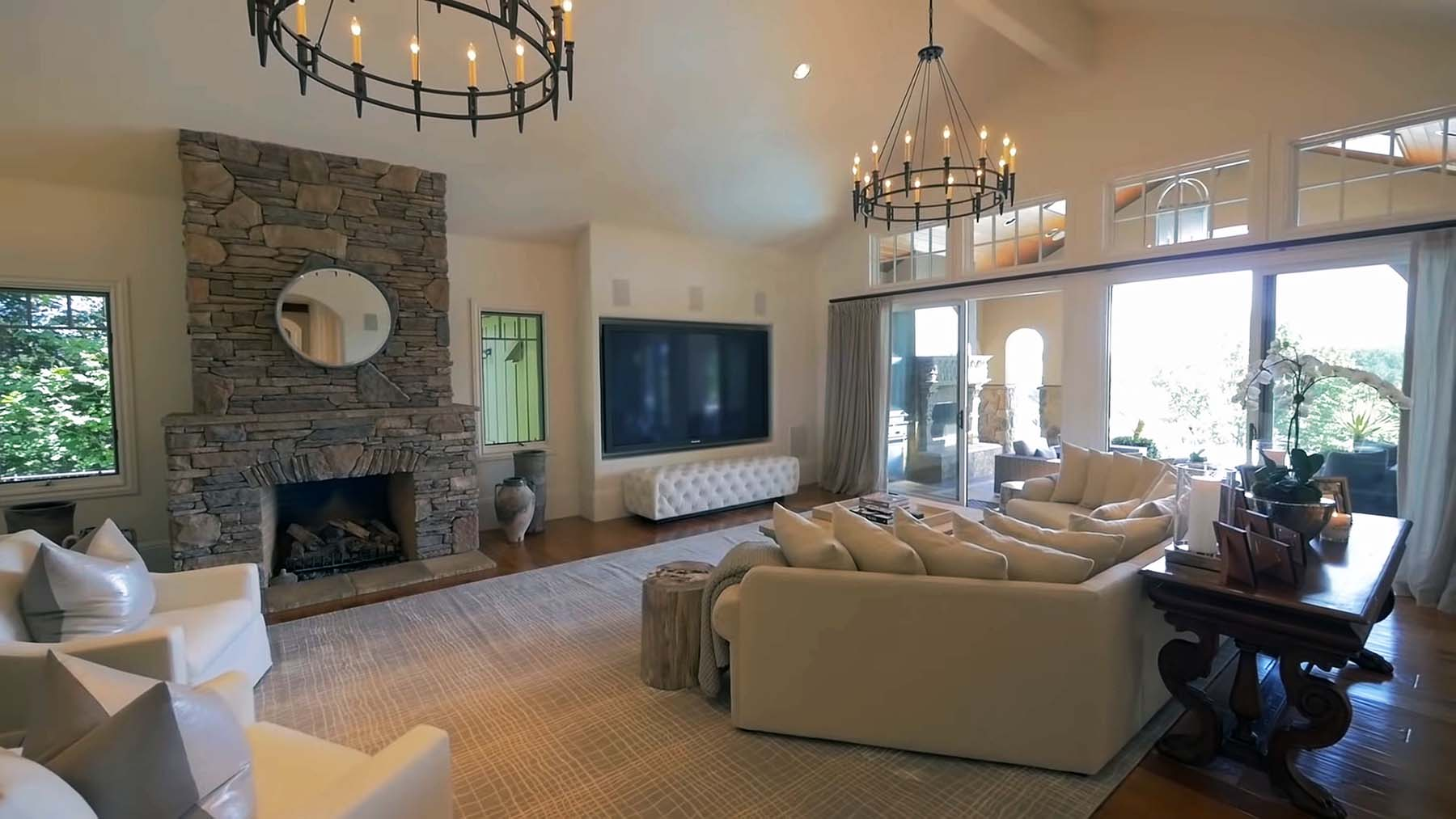 real stacked stone fireplace with stone shelf and hearth living room
