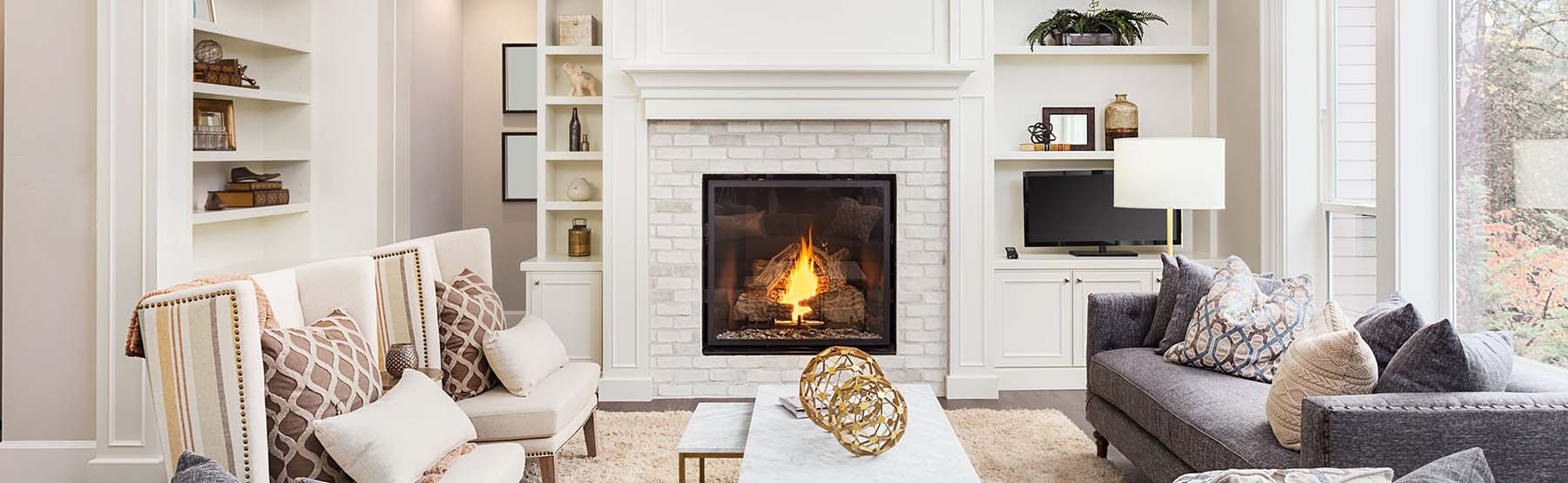 Painted White brick fireplace with built ins