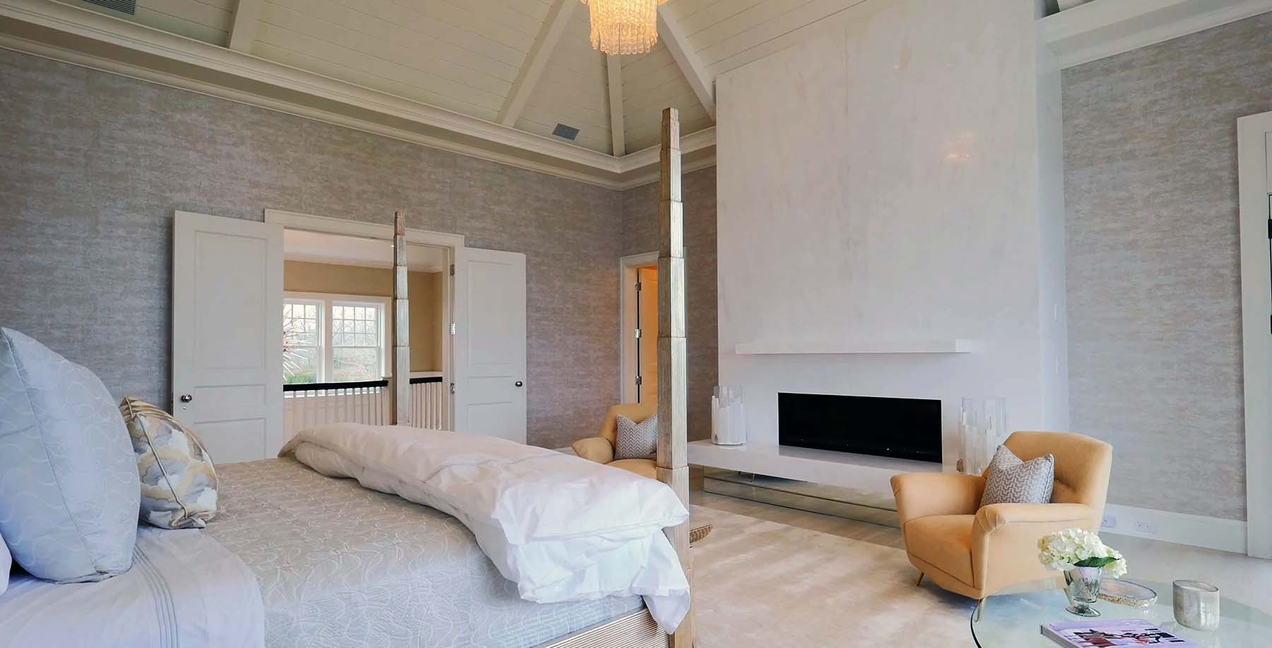 modern bedroom stone slab fireplace surround with contemporary gas fireplace