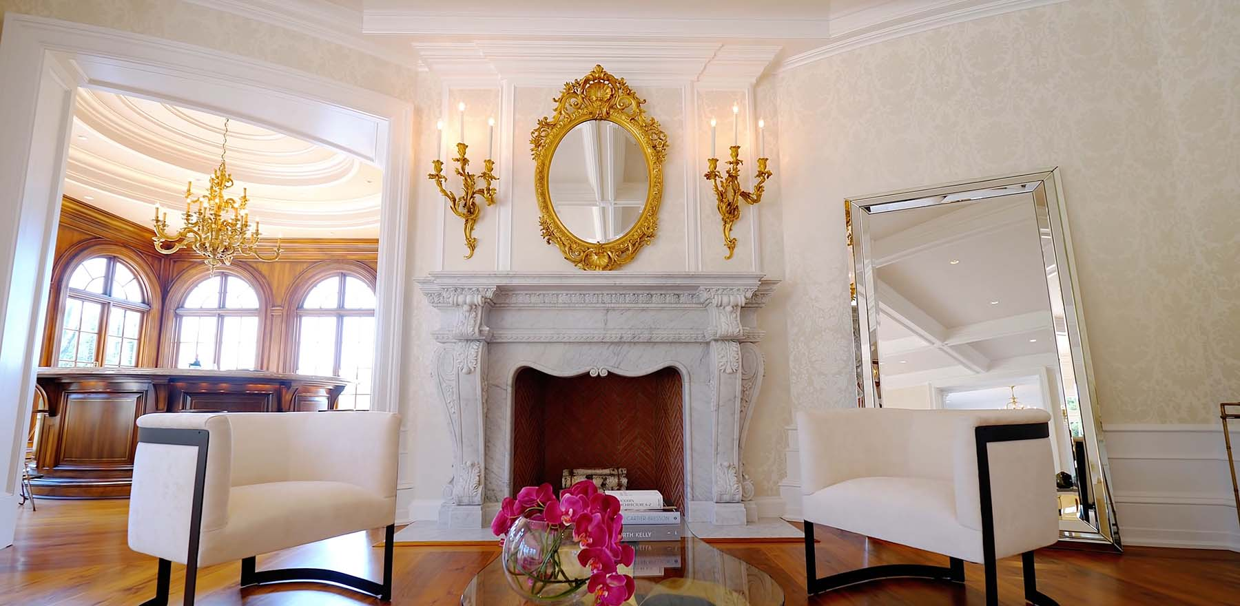 carved marble fireplace surround in a french inspried mansion