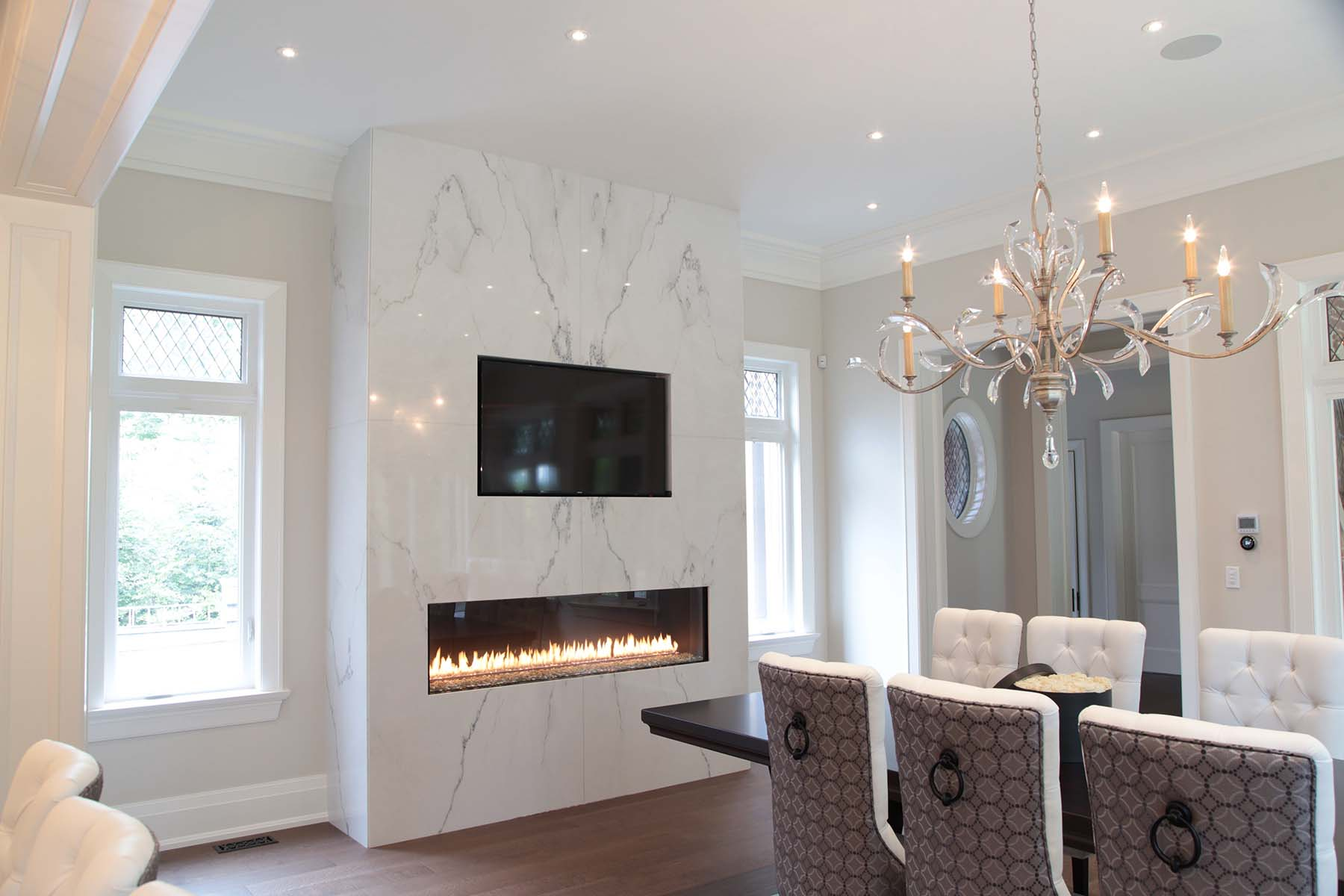 modern marble fireplace surround with modern gas fireplace and wall mounted TV