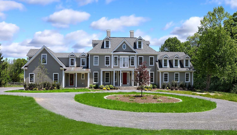 gray home with mahogany front door