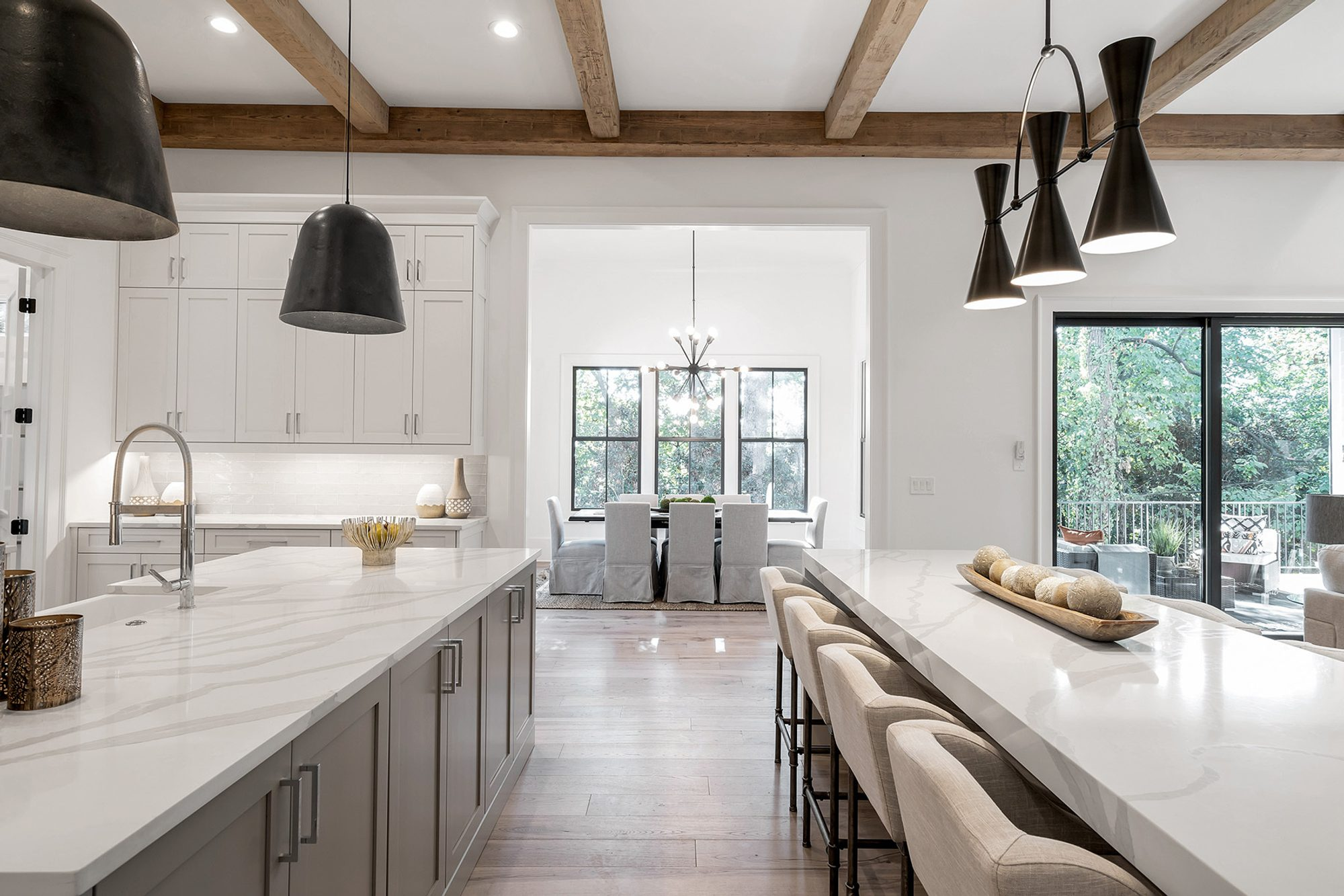 modern home with rustic real wood ceiling beams
