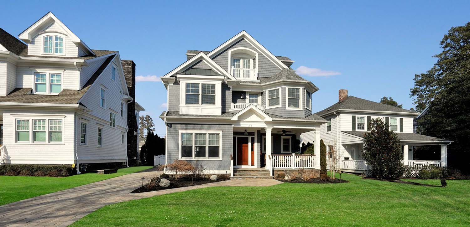 gray siding with mahogany front door black metal accent roof real stone veneer