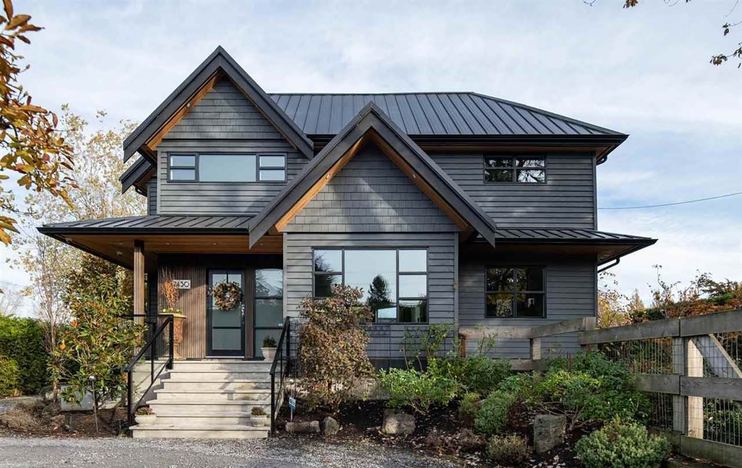 custom home with black siding and wood soffits