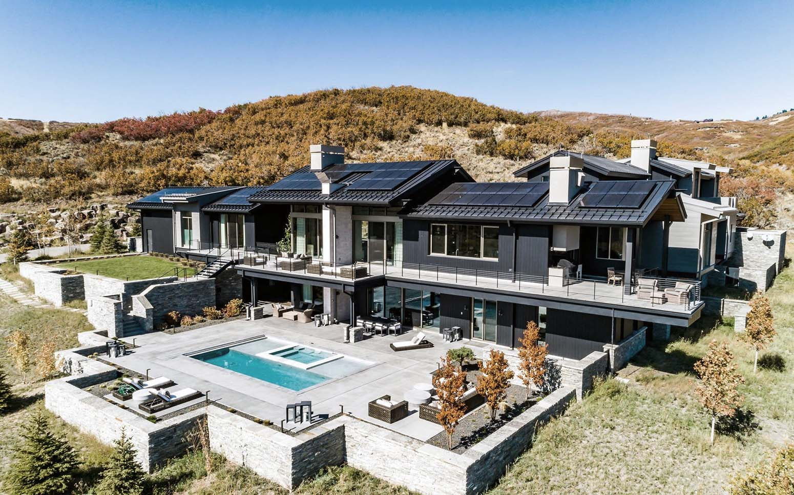 Stunning all black hillside custom home