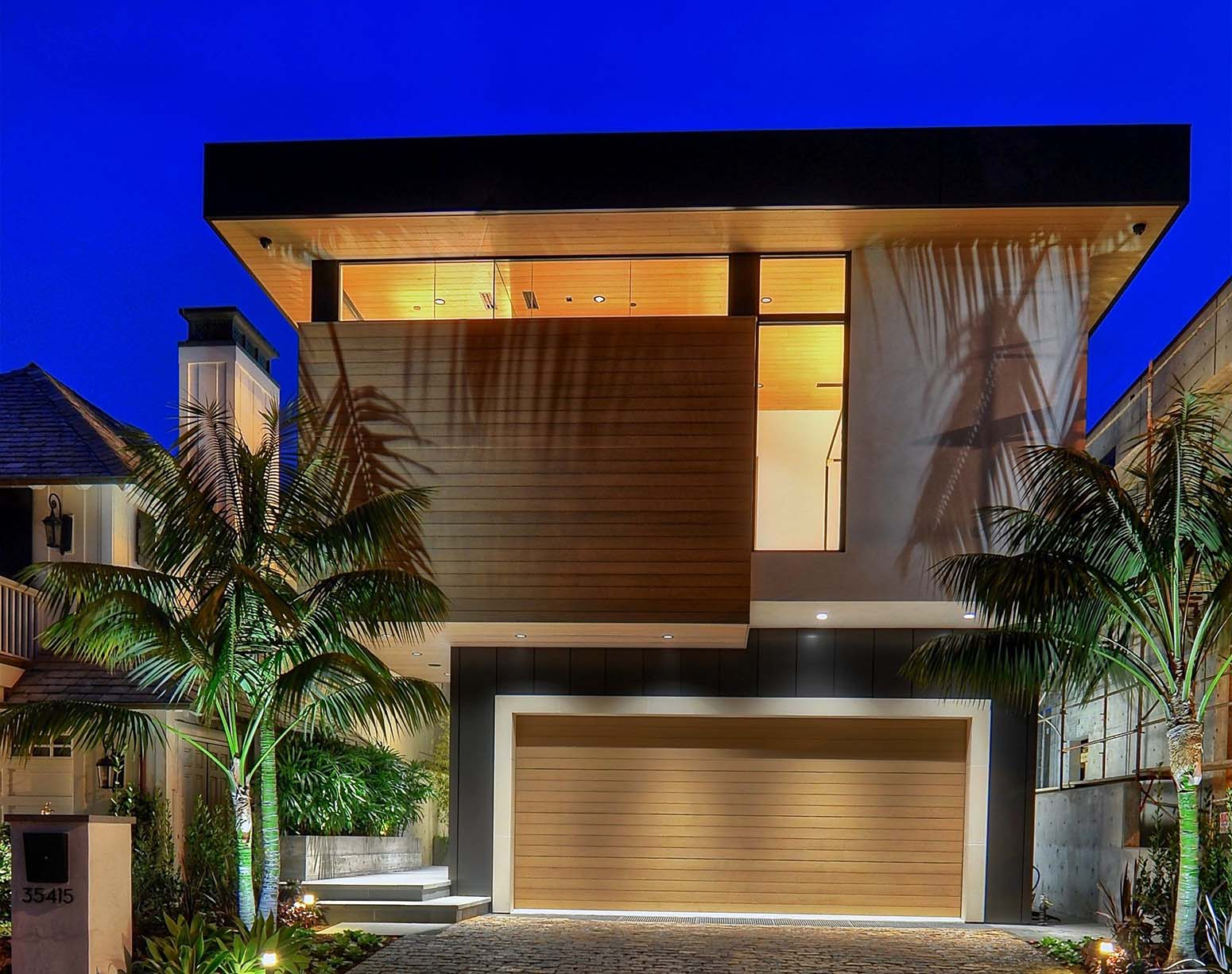 modern beach house with black siding and ipe