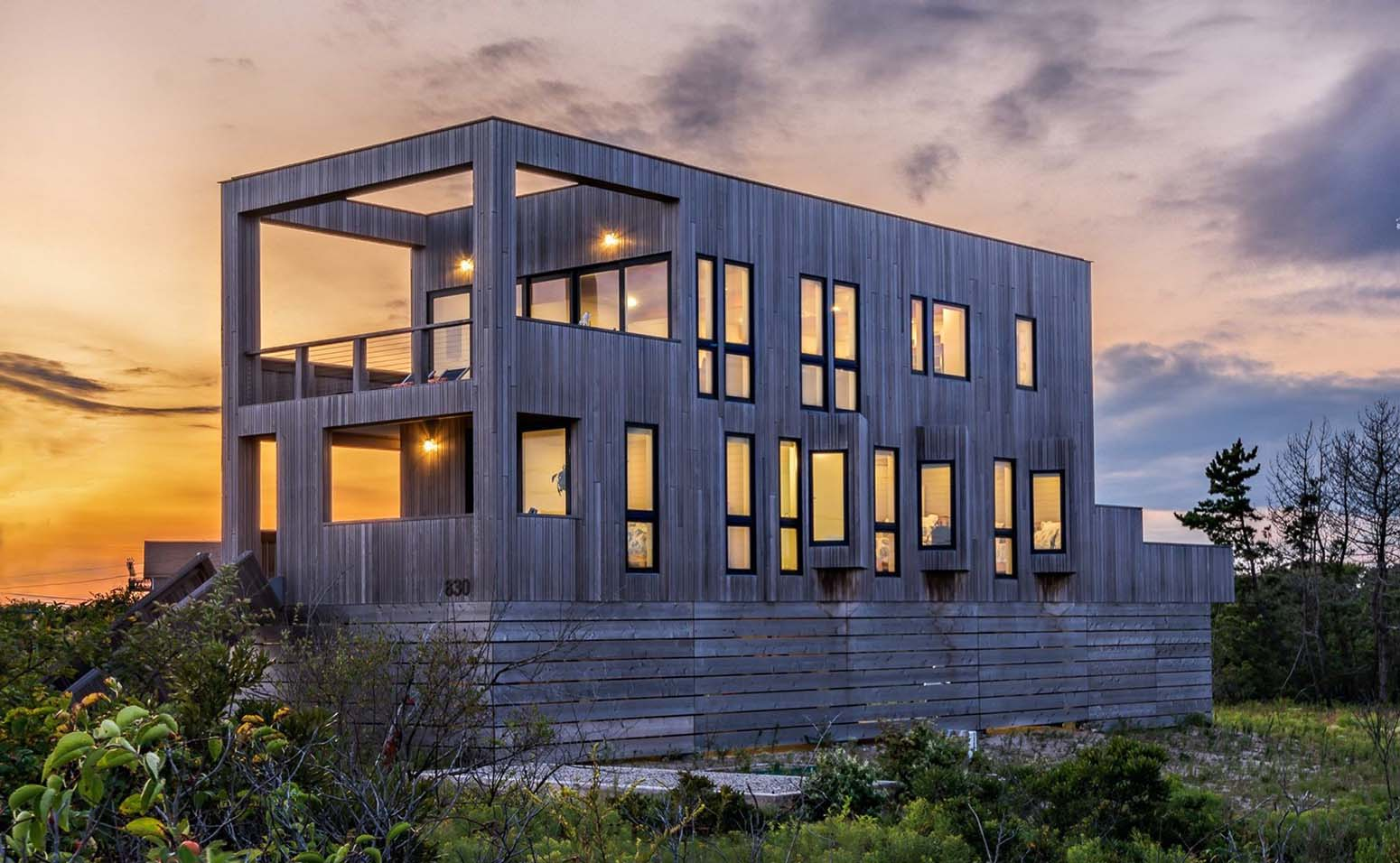 modern black home with wood siding and trim
