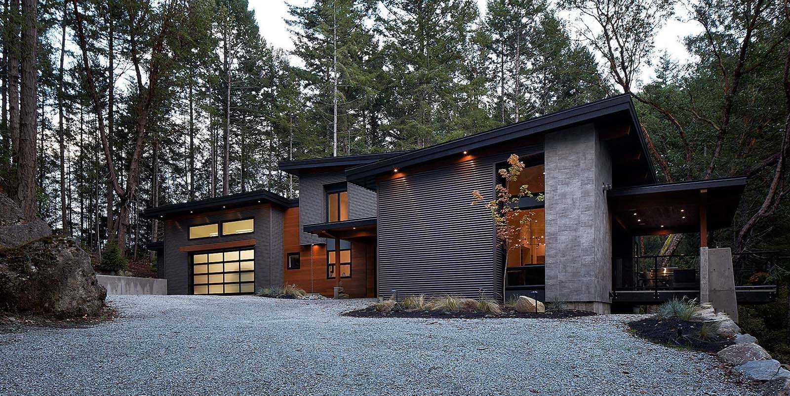 modern house with black siding and real wood
