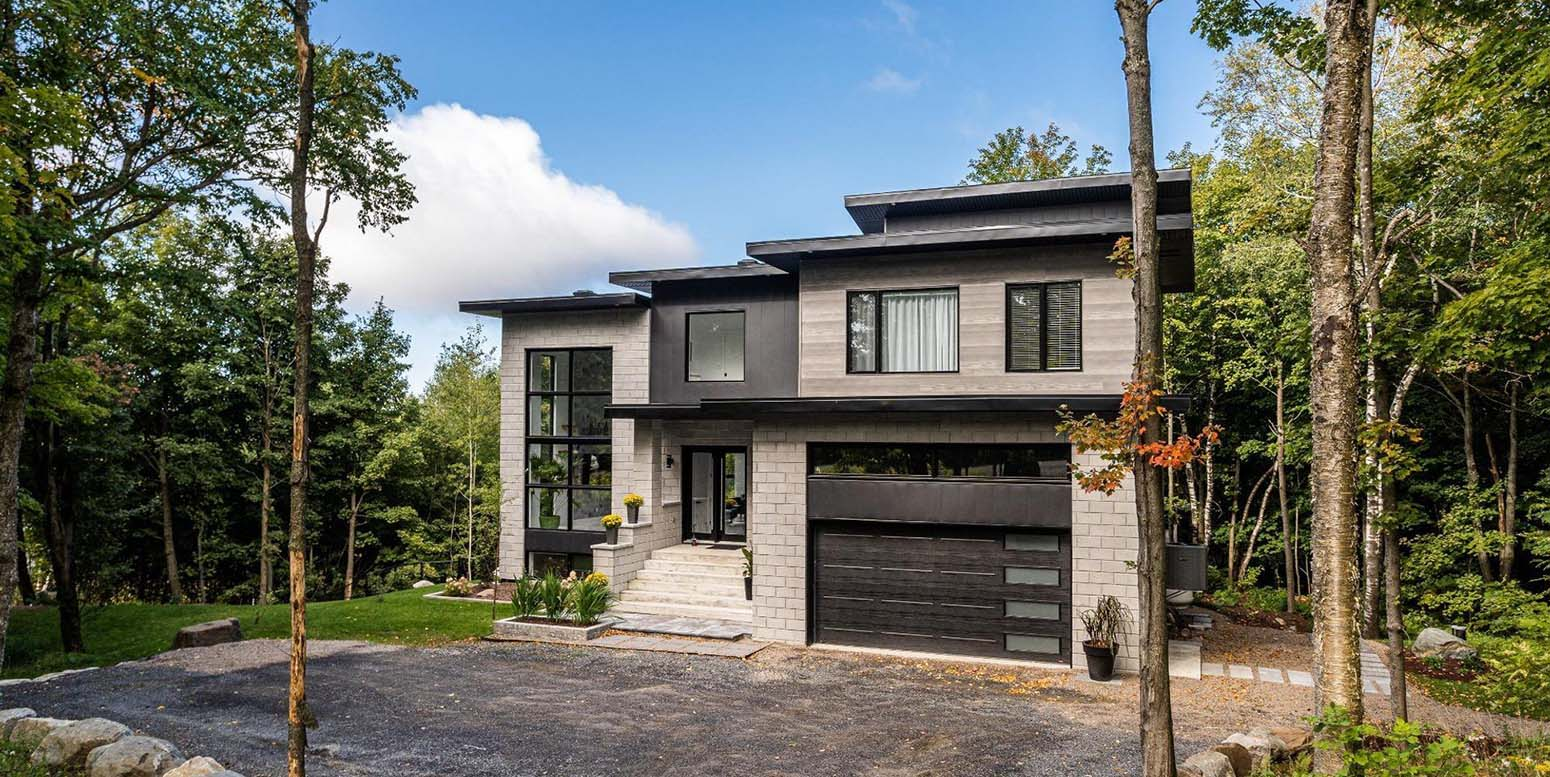 all black and grey house with modern style black garage doors