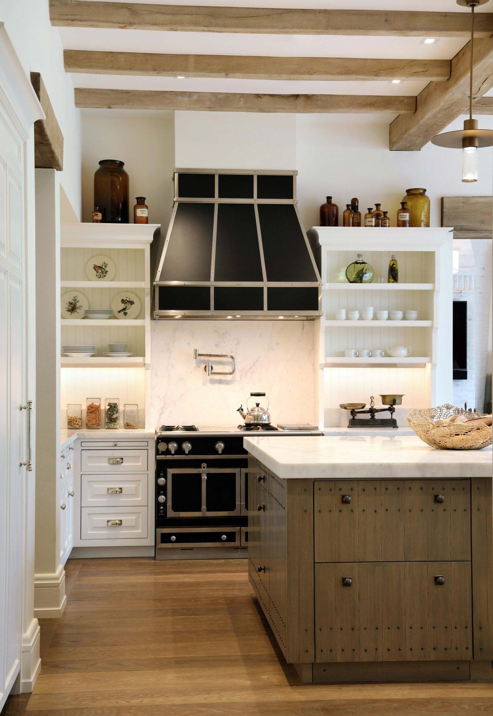 exposed real wood ceiling beams with black stove and range hood
