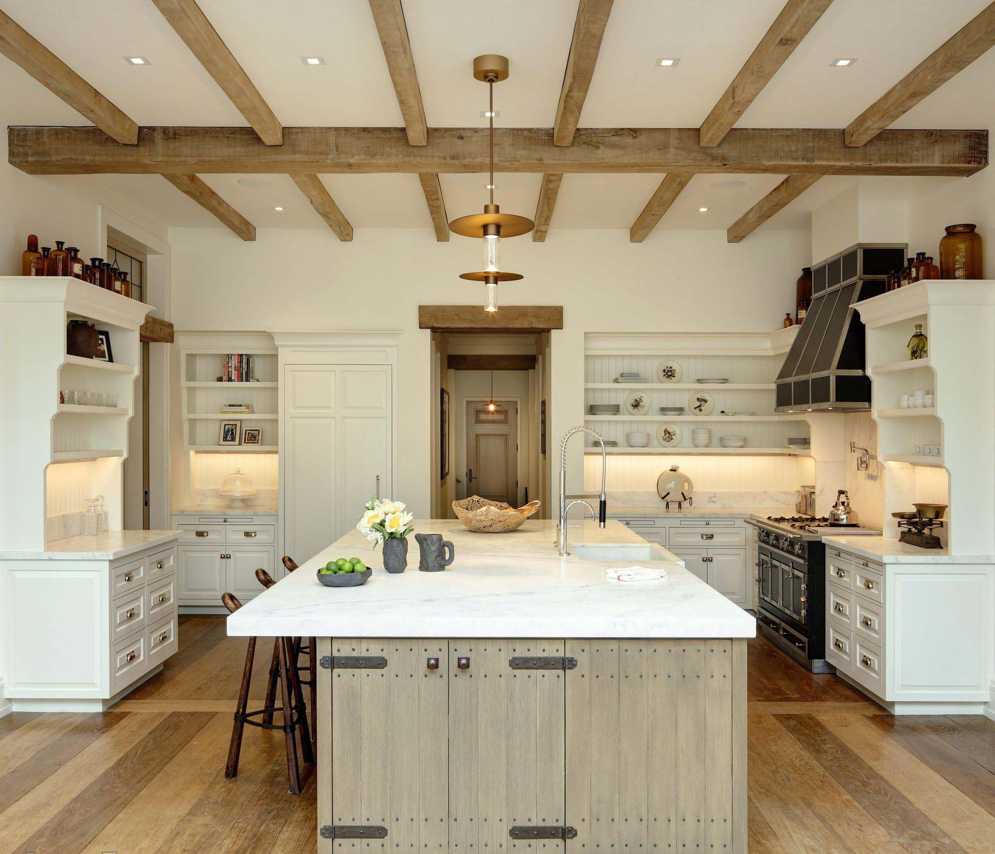 exposed kitchen ceiling beams white cabinets with a black stove