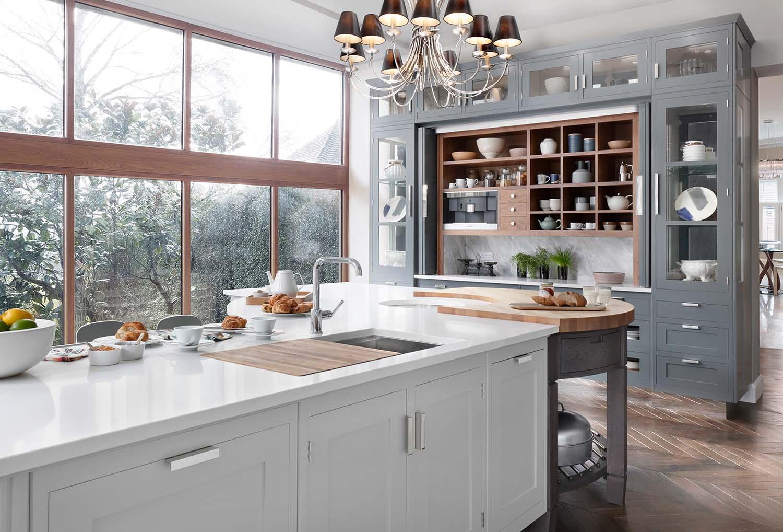 Gray cabinets with silver hardware, marble slab backsplash