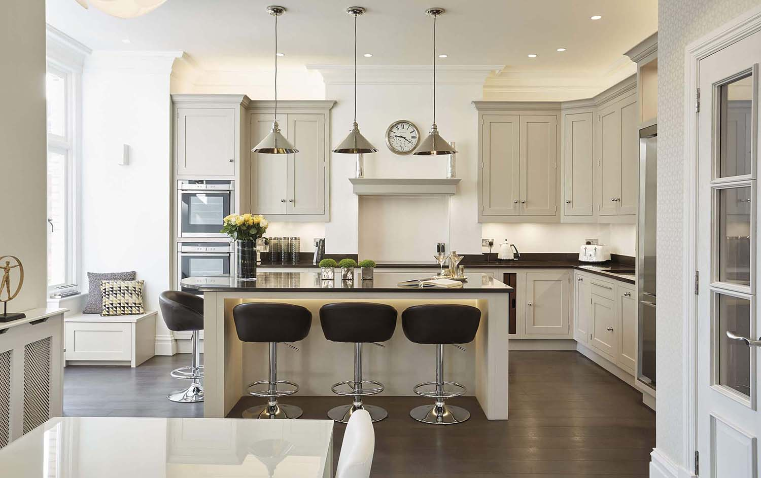 light gray cabinets with marble backsplash and black granite countertops