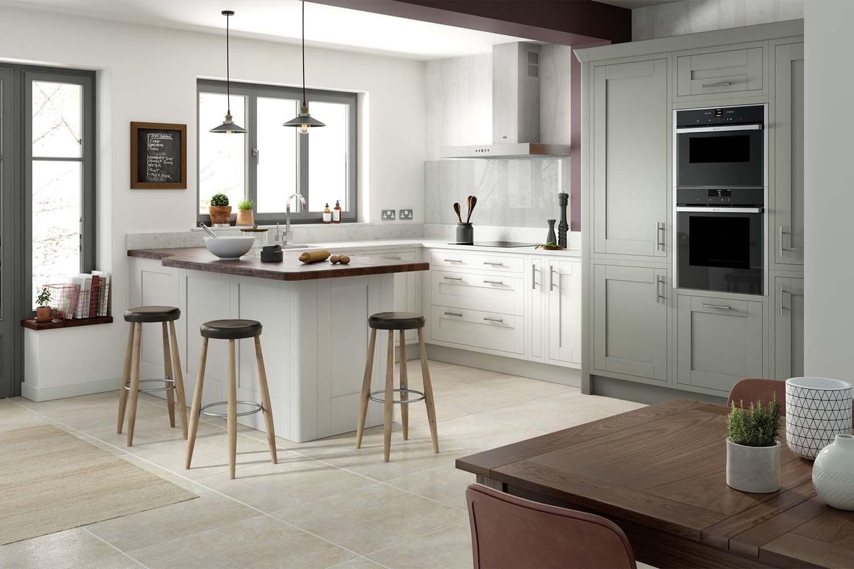 Contemporary kitchen with marble slab backsplash