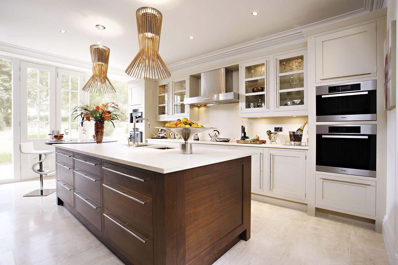 white quartz backsplash with wood island and white cabinets