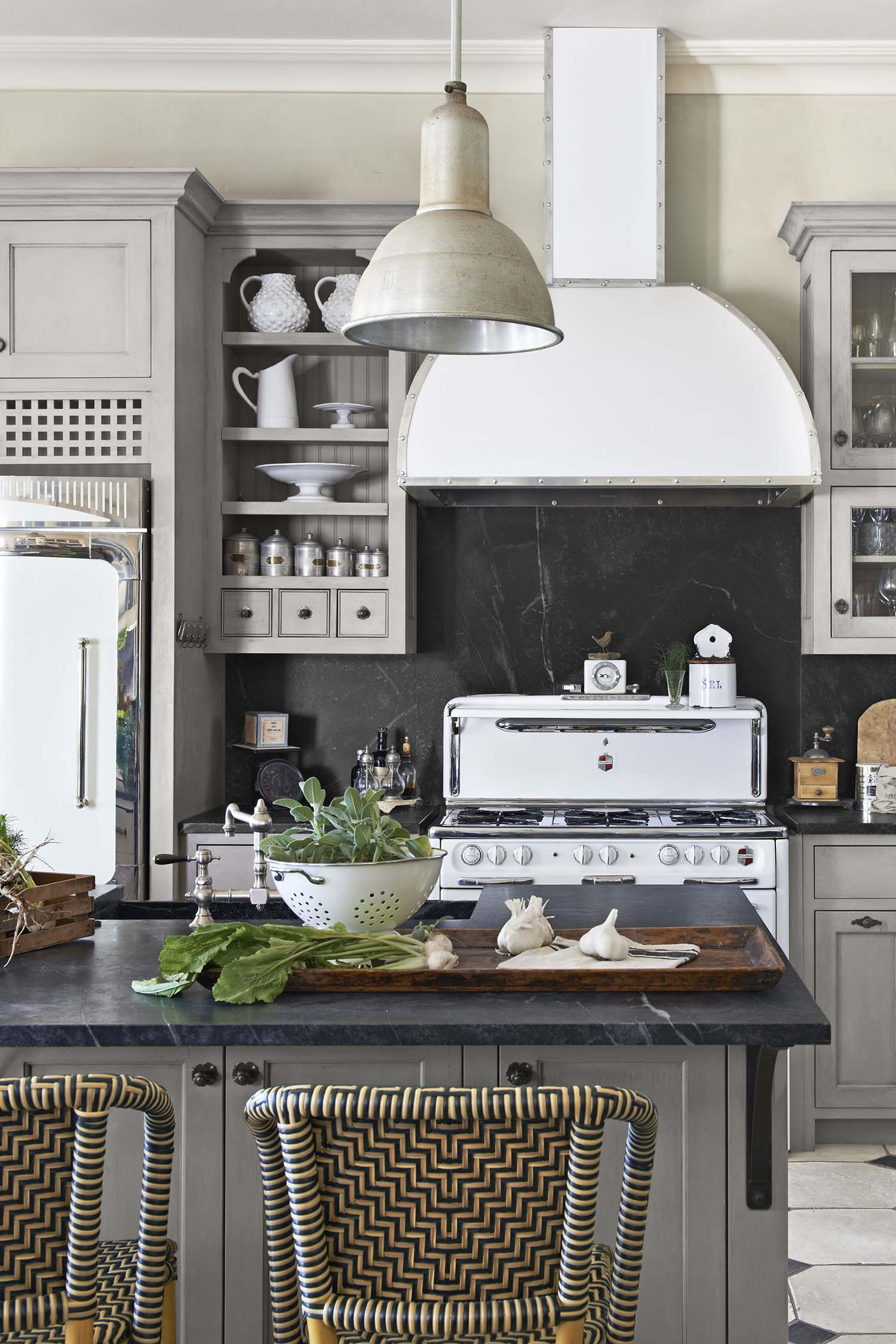 solid black granite backsplash gray cabinets white appliances