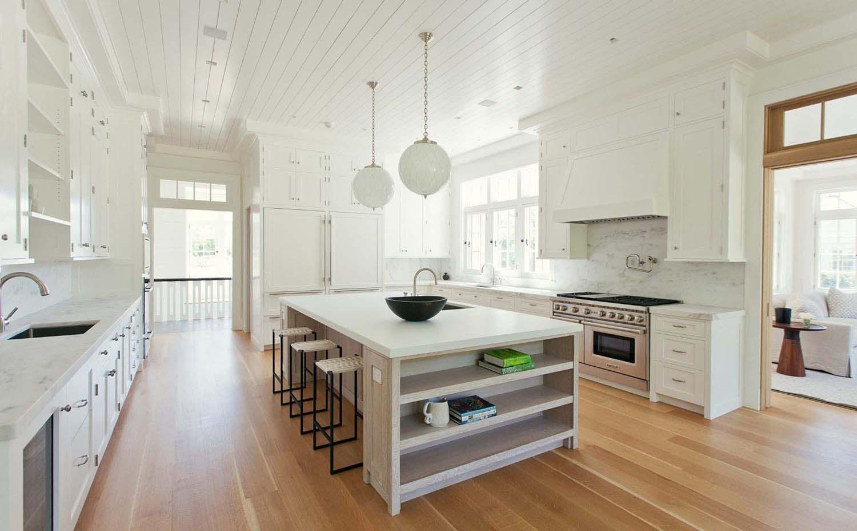 marble slab backsplash white cabinets hardwood floors bead board ceiling