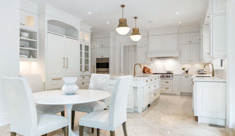 marble slab backsplash white cabinets rose gold fixtures