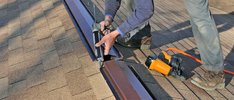metal ridge vent being installed