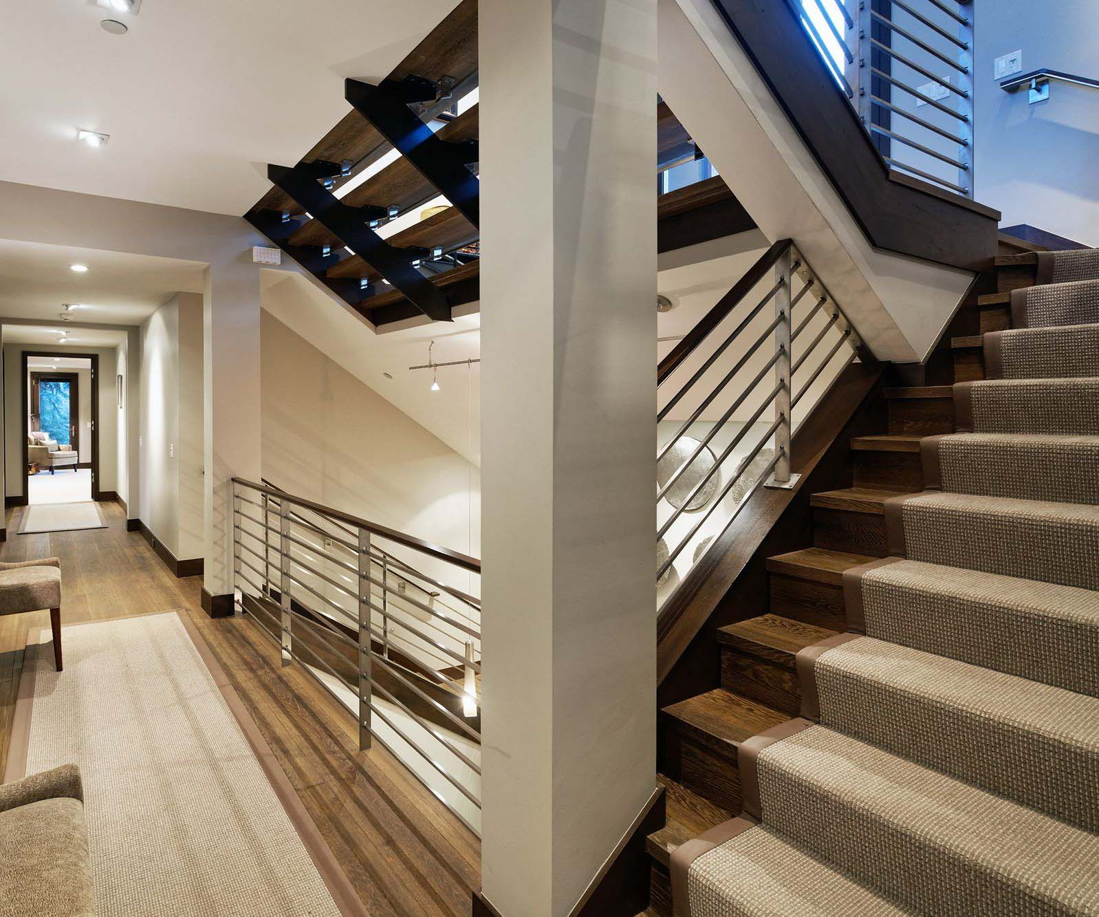 Modern wooden staircase. Dark hardwood floors with open risers and stair runner.