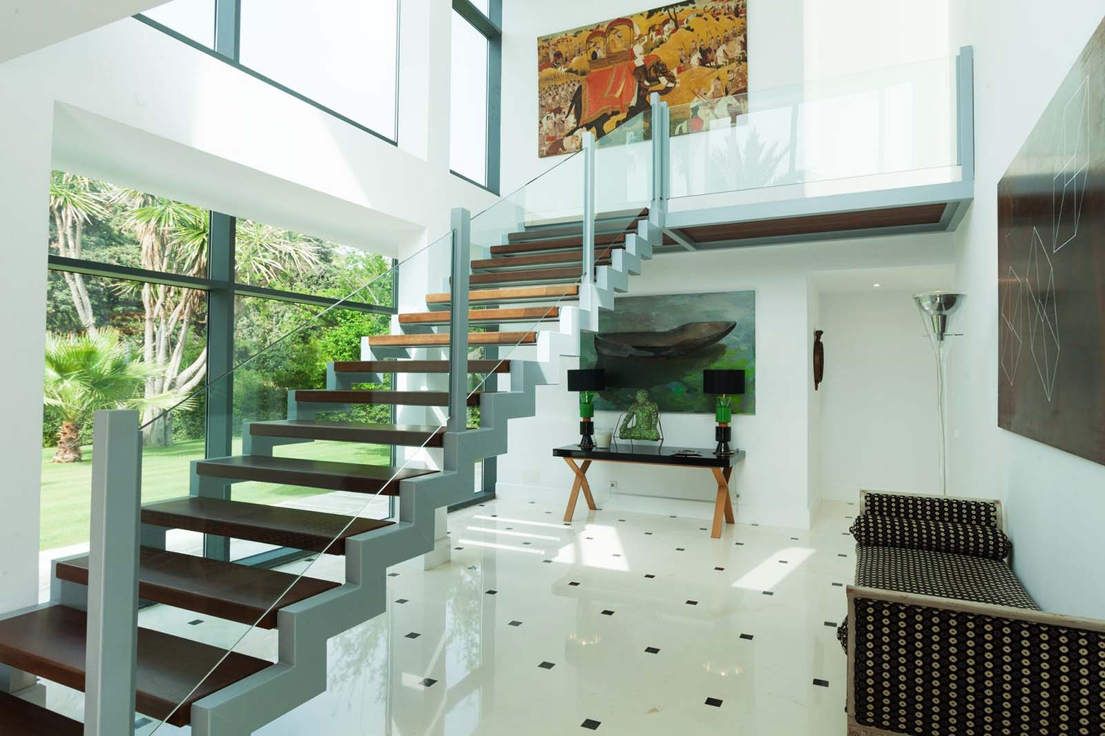 contemporary staircase design ideas silver frame with floating wood steps glass rails
