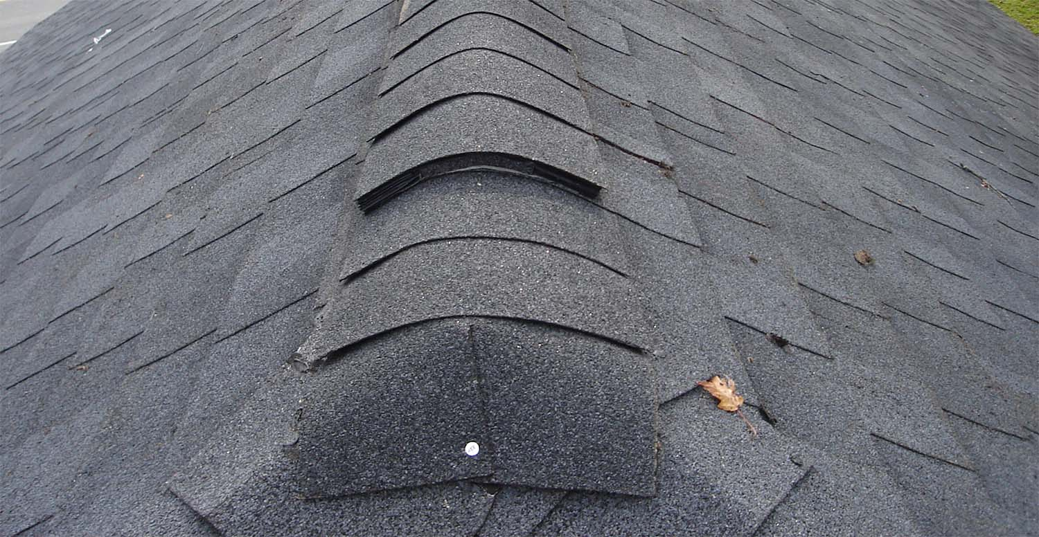 roof shingles with vent cap