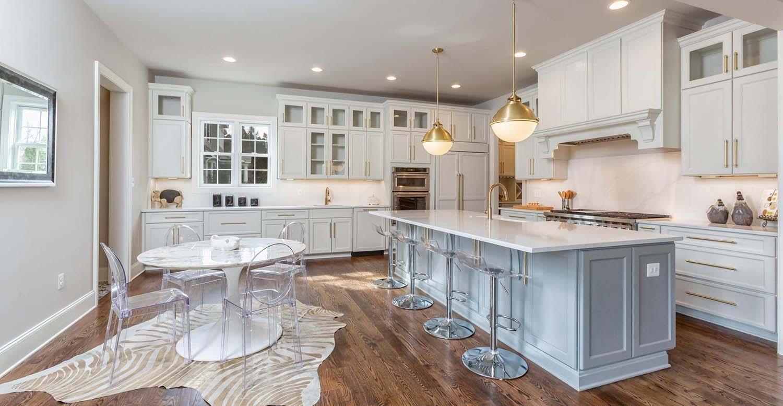 beautiful kitchen quartz solid backsplash and countertops wood floors white cabinets