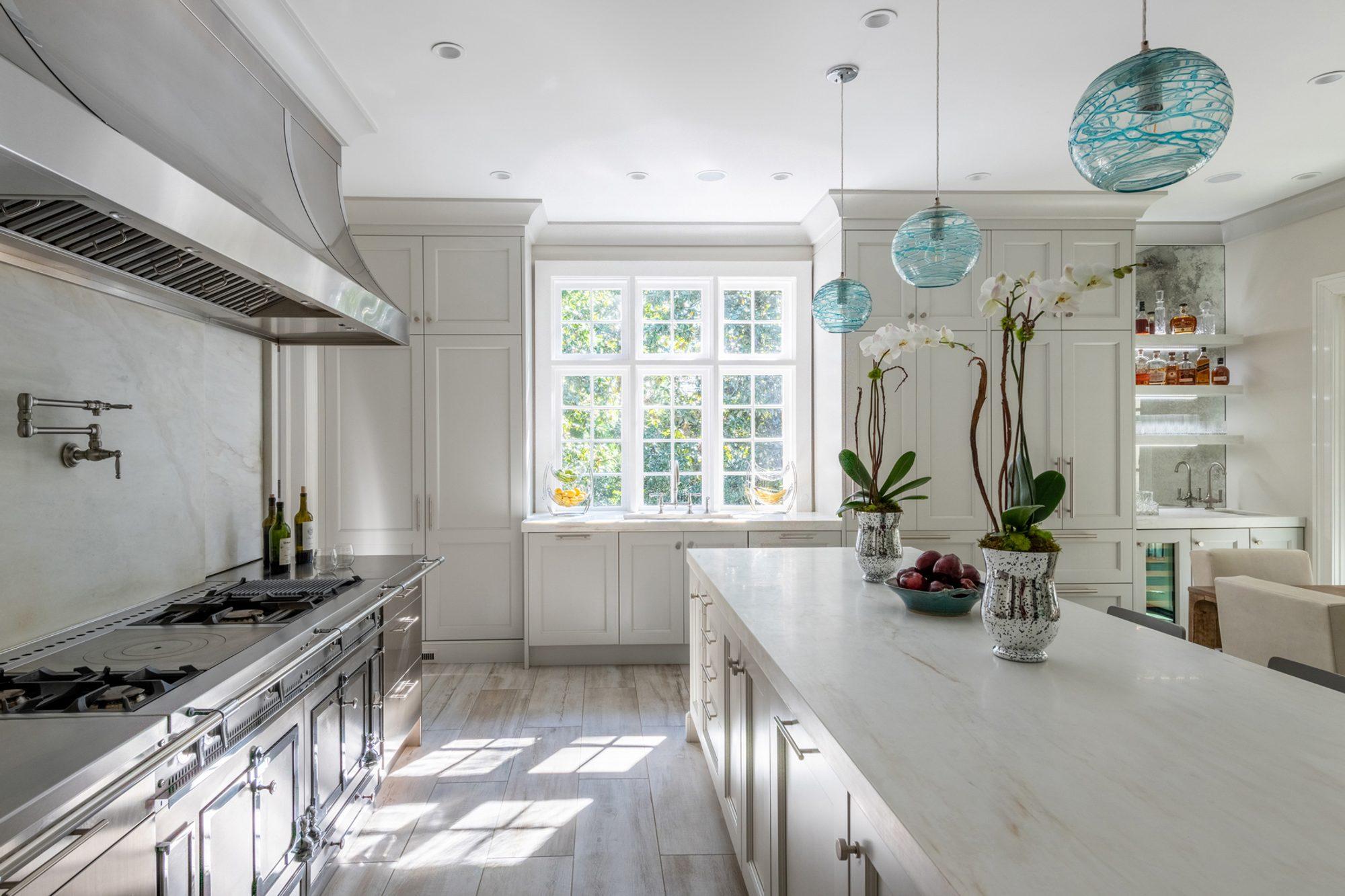 beautiful kitchen quartz solid backsplash and countertops tile floors white cabinets