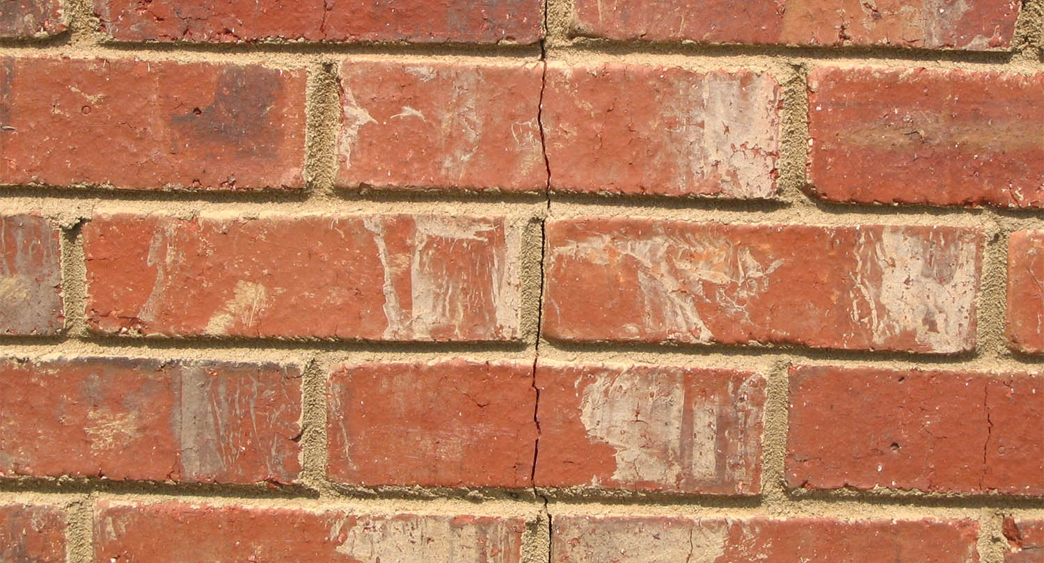 A shifting foundation can cause cracked bricks.