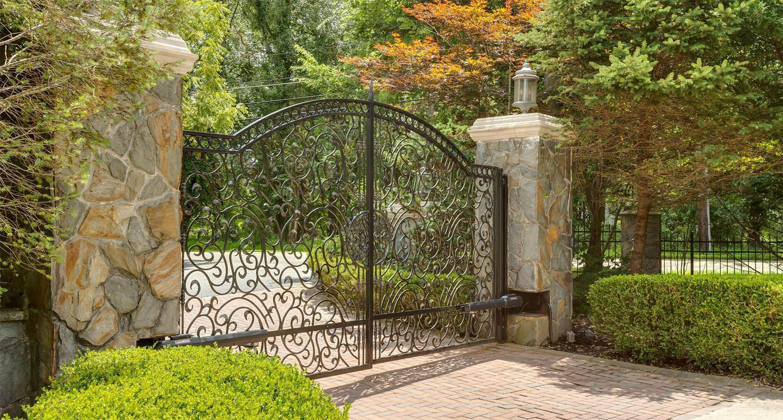 Masonry gate pillars built with mortar and real stone veneer.