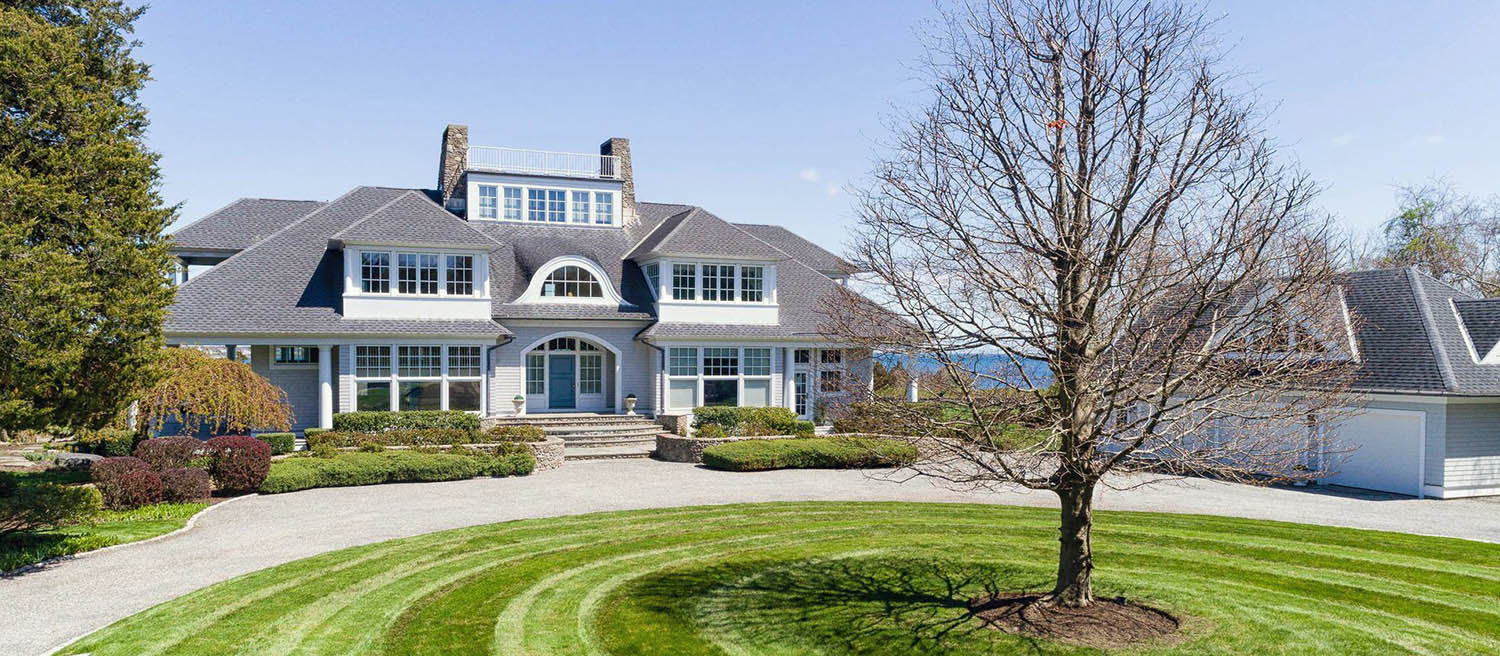 custom gray house with blue front door and white trim